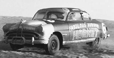 Marshall Teague slaps his Hudson Hornet into the south turn during the 1951 NASCAR Grand National season opener.