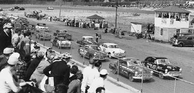 Tim and Fonty Flock lead the charge at the start of the 100-mile NASCAR Grand National race at Martinsville Speedway.