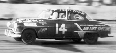 Fonty Flock waves to the crowd as he thunders under the checkered flag to win the Southern 500.