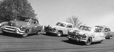 Publicity photo of the cars of Fonty Flock (#14), Herb Thomas (#92), Tim Flock (#91), and Curtis Turner (#41).