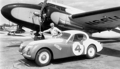 Al Keller poses with his Jaguar sports coupe at New Jersey's Linden Airport.