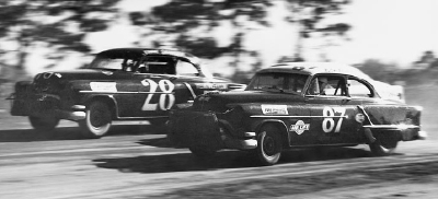 Buck Baker finished third in the 1954 NASCAR Grand National points standings and won four races in #87.