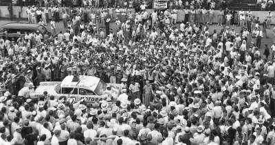 Follow­ing the 1955 Southern 500, a crowd surrounds Herb Thomas' winning Chevrolet on Victory Lane.