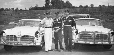 A flock of Flocks: Fonty, Bob, and Tim pose with a pair of the speedy Carl Kiekhaefer Chryslers.