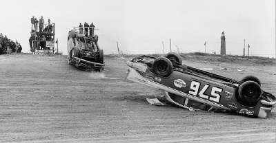 Jim Wilson's #576 1956 Dodge lies upside down after an early spill in the south turn at Daytona.