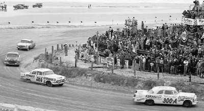 Tim Flock and Speedy Thompson hustle through the north turn of the Daytona Beach NASCAR Grand National race.