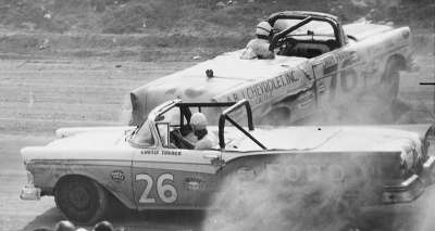 Larry Frank loops his #76 Chevy convertible as Curtis Turner slides past during the Feb. 16 NASCAR Convertible race.