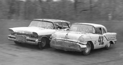 Number 42 Lee Petty and Jim Paschal race in close quarters in the March 24 race at Hillsboro, N.C.
