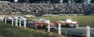 Curtis Turner, driving his #26 Ford, with #21 Glen Wood on the front row of the NASCAR Convertible race.