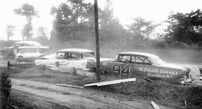 Clarence DeZalia's #94 Mercury gets entangled in a three-car mishap during a short-track event.