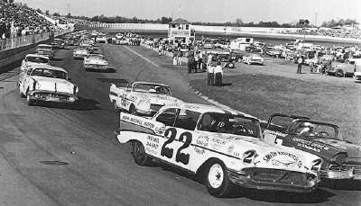 Fireball Roberts flanks pole sitter Glen Wood on the front row at the start of the Martinsville Speedway Sweepstakes race.