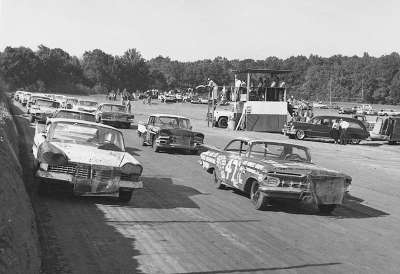 Jack Smith's #47 Chevrolet and Richard Petty's Plymouth for the 99-mile NASCAR Grand National race at Hillsboro.