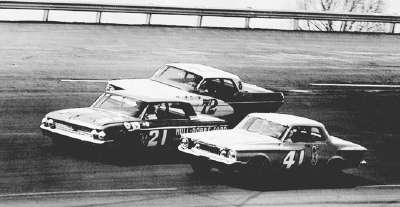 Number 21 Marvin Panch and #72 Bobby Johns pass Maurice Petty's #41 Plymouth during Bristol's Volunteer 500 on April 29.