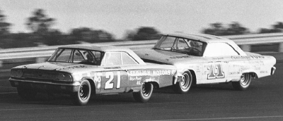 Number 21 Tiny Lund and #11 Ned Jarrett battle in the late stages of the Daytona 500.