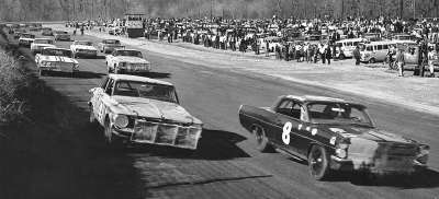 Number 8 Joe Weatherly and #41 Jim Paschal start on the front row for the NASCAR Grand National race at Hillsboro.