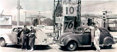 A brace of 1934 DeSotos at a Los Angeles fuel stop.