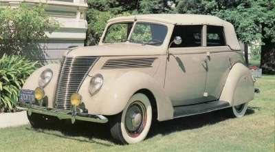 DeLuxe models, like this 1937 Ford DeLuxe convertible sedan, offered considerable features for a reasonable price.