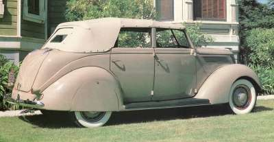 Seen in profile, the 1937 Ford DeLuxe convertible sedan captures the new look of the year.