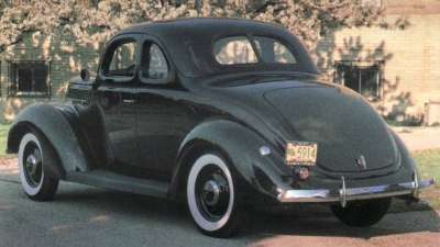 The rear view of the 1937 Ford Model 74 shows the sharply sloping trunk lid.