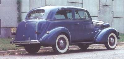 A triangular badge identified the 1938 Chevrolet sedans from the rear.