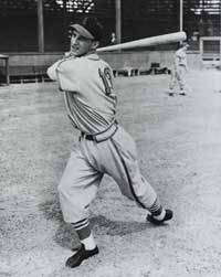 Stan Musial of the St. Louis Cardinals,  played in 3,026 games and hit 475 homers during his career.