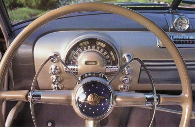 Even the planet-and-stars steering wheel hub gave the Oldsmobile Futuramic 98 unique styling.