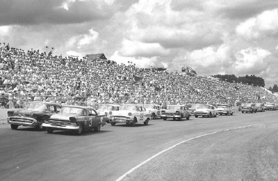 Paul Goldsmith and Buck Baker lead the field on the pace lap of the 1957 Virginia 500.
