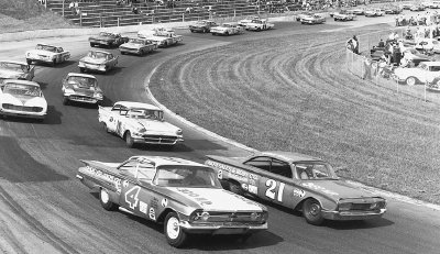Number 21 Jimmy Massey and #4 Rex White battle side-by-side on Martinsville's tight 1/2-mile track during the 1960 Virginia 500.