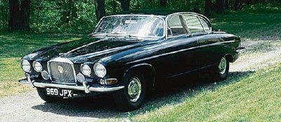 The 1963 Jaguar Mark X sedan, part of the 1961-1965 Jaguar Mark X series of collectible cars.