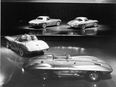 The Stingray racer and 1960 XP-700 show car front the new 1963 Corvette convertible and fastback.