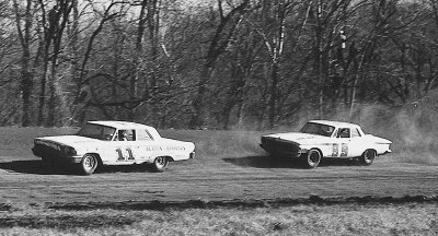 Ned Jarrett and Bobby Isaac kick up the dust in the 1963 race at Orange Speedway in Hillsboro, NC.