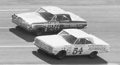 #54 Jimmy Pardue and #26 Bobby Isaac in a photo finish with Richard Petty in the Twin-100 miler at Daytona.