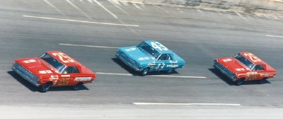 Number 25 Paul Goldsmith, #43 Richard Petty, and #26 Bobby Isaac battle for the lead in the 1964 Daytona 500.