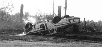 Larry Thomas' Dodge lies upside-down after a crash in the 1964 NASCAR Grand National Jacksonville event.