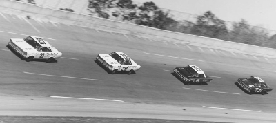 #27 Junior Johnson leads #28 Fred Lorenzen, #15 Earl Balmer, and #21 Marvin Panch in the 1965 Daytona 500.