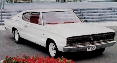 A white 1966 Dodge Charger fastback.
