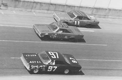 Number 97 Henley Gray, #40 Jerry Grant and #11 Mario Andretti race in the 1967 Daytona 500.