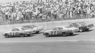 Sam McQuagg, Cale Yarborough, Bobby Isaac, and David Pearson battle in the July 4, 1967 Daytona Firecracker 400.