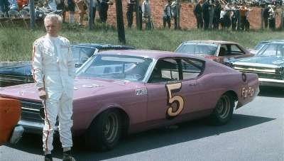 Pete Hamilton stands beside the #5 Ford owned by Rocky Hinton before the May 5, 1968 Fireball 300.
