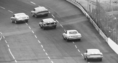 Bobby Allison, Earl Balmer,  Tiny Lund, Buddy Baker, and  David Pearson race in the 1968 World 600.
