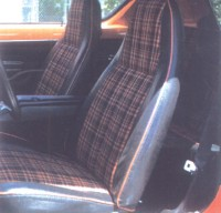 Interior choices for the X included a black-and-orange plaid, perfect for this car's Sun Orange paint.