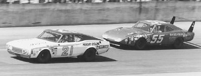 Cale Yarborough leads Tiny Lund in the early laps of the Feb. 22 Daytona 500.
