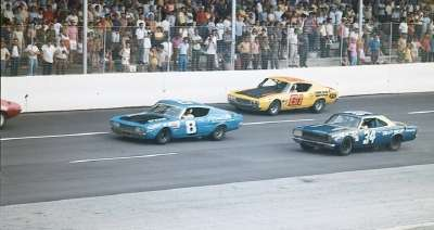 Number 8 Ed Negre, #61 Hoss Ellington, and #34 Wendell Scott race in the Sept. 7, 1970 Southern 500.