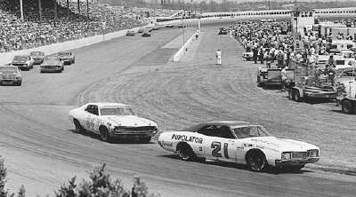 Number 21 David Pearson puts a lap on #34 Wendell Scott in the April 30 Virginia 500 at Martinsville Speedway.