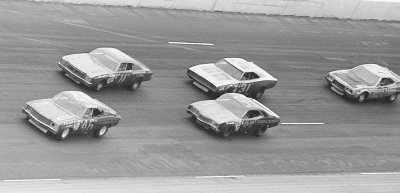 Roy Mayne, Coo Coo Marlin, Darrell Waltrip, Jim Vandiver, and Fred Lorenzen race in the 1972 Winston 500.