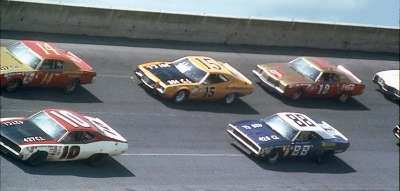 A quintet of speedy cars tour the high banks of Daytona in the July 4, 1972 Firecracker 400.
