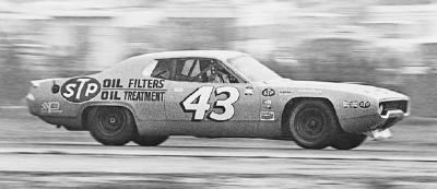 Richard Petty throttles his #43 STP Plymouth down the straightaway during the Jan. 23, 1972 Winston Western 500.