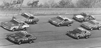 A gaggle of cars run in tight formation in the second Twin 125-miler at Daytona International Speedway in 1973.
