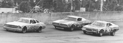 Number 95 Darrell Waltrip leads #31 Jim Vandiver and #90 Bill Dennis during the 1974 Daytona 500.