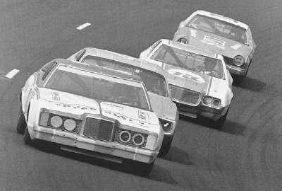 David Pearson's Wood Brothers Mercury leads Richard Petty, Buddy Baker, and Bobby Allison in the Aug. 25 Yankee 400.